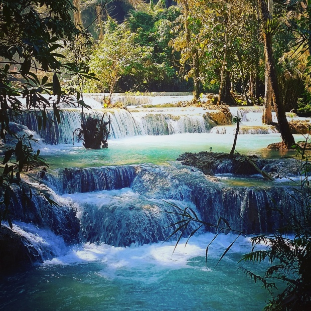 The incredible turquoise pools at the bottom of Kuang Si waterfall